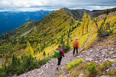 Two fit women enjoy a fall hike in the mountains near Whitefish, Montana.