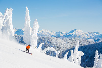 Max Curtis snowboards with Glacier National Park and snowghost at Whitefish Mountain Resort. (C) Craig Moore