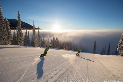 A couple ride down Inspiration at Whitefish Mountain Resort.