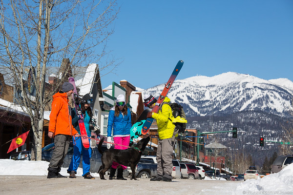 friends cross paths in downtown Whitefish Montana with Whitefish Mountain Resort in the background.