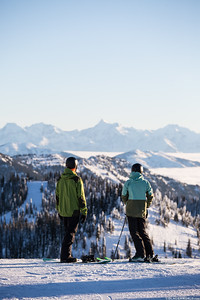 A couple at the summit over looking Glacier National Park at Whitefish Mountain Resort.