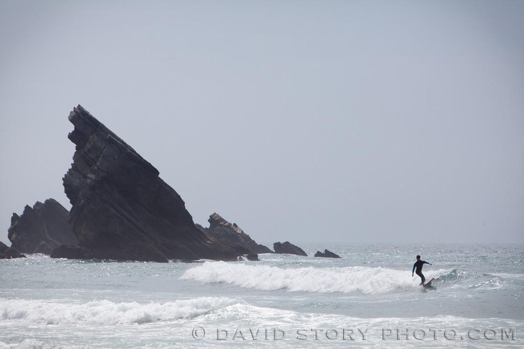 Surfing at Praia, Adraga, Portugal.