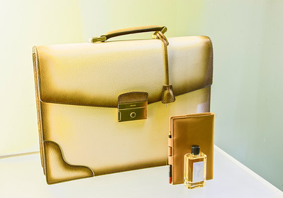 Golden leather business bag wigh diary and perfume bottle