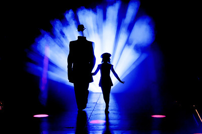 Black silhouette of a girl and a man without face