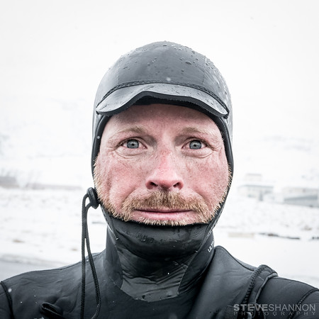 After an hour surfing Ollie's Point in Olafsfjordur, Iceland (just south of the Arctic Circle), this was Robbie's face.  Cold doesn't even begin to describe surfing in Iceland.  Surfer: Robert Stoeckel