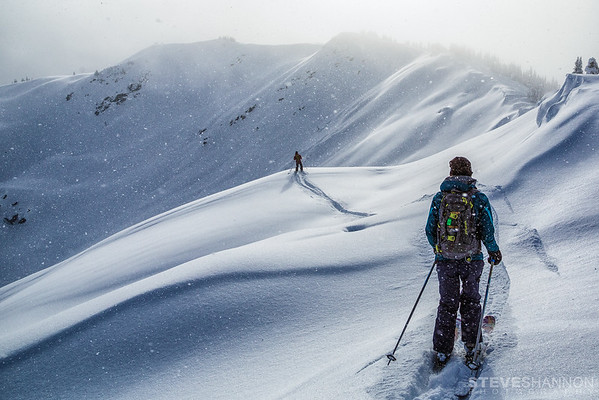 Heading out for another run at Selkirk Wilderness Skiing.<br /> Skiers: Ramin Sherkat (guide) and Hannah Miner<br /> Location: Selkirk Wilderness Skiing, BC