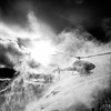 The helicopter kicks up a powder cloud as it lands, dropping off heliskiers for another run at Stellar Heliskiing in British Columbia's Purcell Mountains.