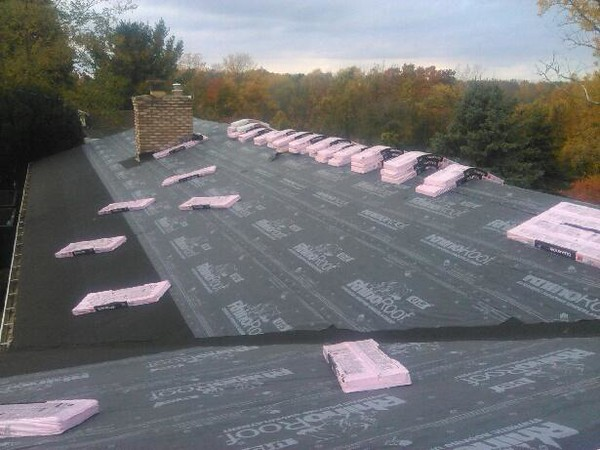 SYNTHETIC UNDERLAYMENT AND ICE & WATER SHIELD (STANDARD) NOTICE THE ICE & WATER SHIELD IN THE VALLEYS TOO!!!!