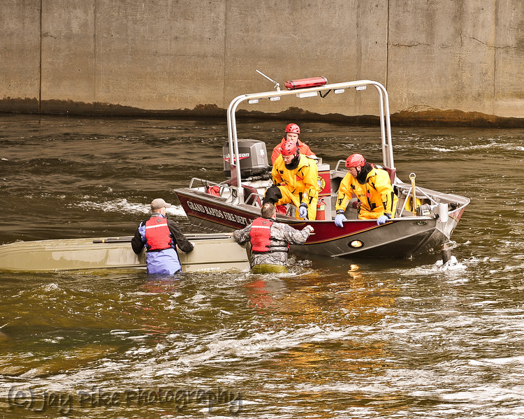 GRFD's River Rescue Team responded and pulled both men safely from the rapid current of the river.