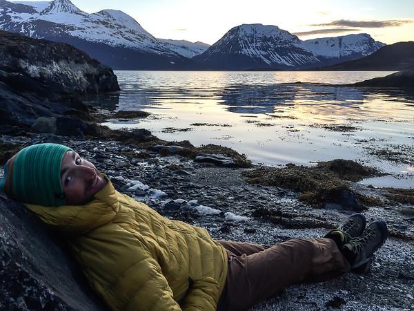 Relaxing on the shores of Ullsfjorden, Lyngen Alps, Norway.