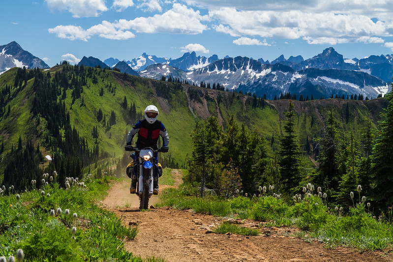 An offroad motorcyclist explores Hailstorm ridge in the Valhalla mountains of British Columbia.