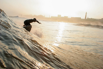 Golden sunset surfer by Maarten Huisman