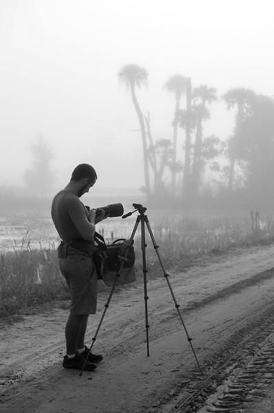 Setting up camera gear in early morning fog at Orlando Wetlands<br /> Photo by Ryan Chabot