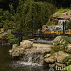 A Japanese water garden incorporates a model train layout, complete with railroad trestle at the estate of Elaine Silets in North Barrington July 25, 2006.