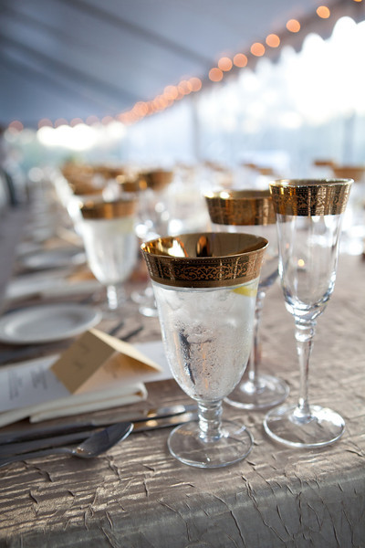 Gold rimmed glassware gives any event a rich, elegant feel.  (Photo by David Hanson)