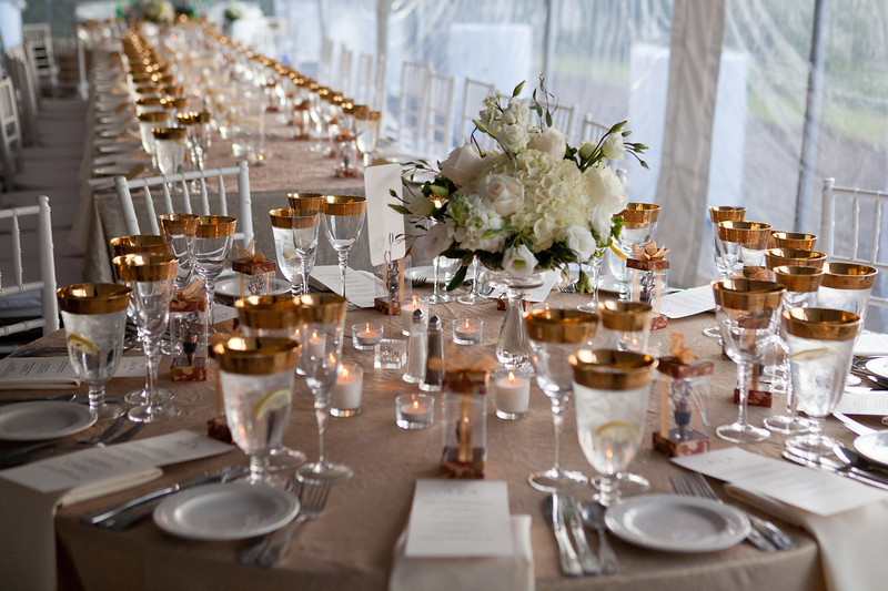 The combination of softer tones and simpler flowers keeps the focus on the couple and their guests.  (Photo by David Hanson)