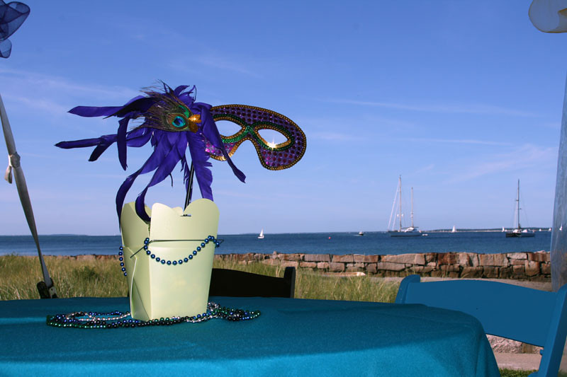 The decor from a beach side Mardi Gra themed fundraiser