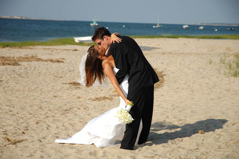Bride and groom share a kiss before their seaside Cape Cod wedding. - Home - The Casual Gourmet, Cape Cod Wedding Caterer