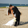 Bride and groom share a kiss before their seaside Cape Cod wedding.
