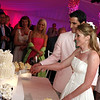 Bride and groom cut the cake at their night club themed Cape Cod wedding.