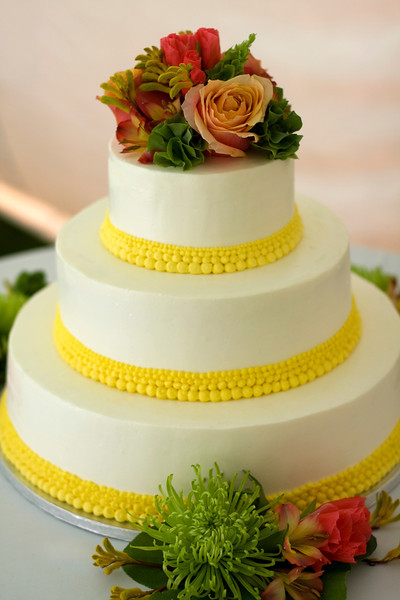 A lemon yellow dotted band on a Cape Cod wedding cake from The Casual Gourmet