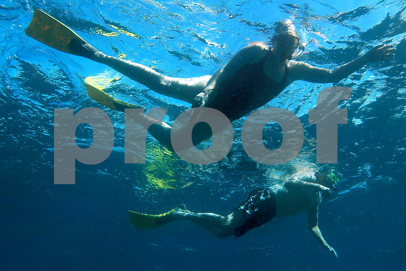 Sandy & John during dolphin swim at Kailua Bay