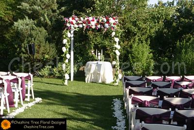 !polupanova-08-castle-hotel-and-spa-wedding-flowers-ceremony-arc