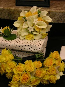 White calla, stephanotis with pearls , callas, yellow roses  $125
