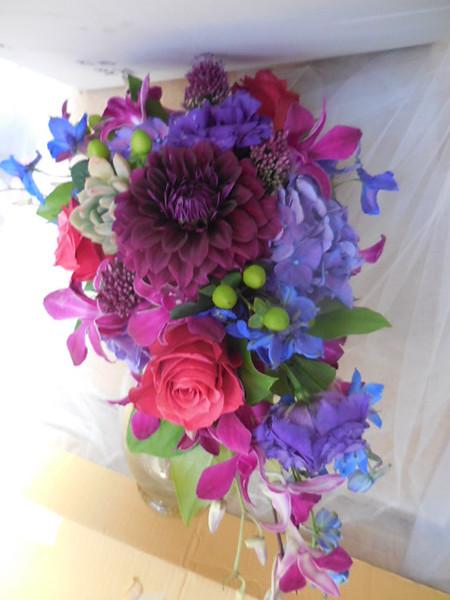 Cascading bouquet dahlias, beans, roses Lavender hydrangea orchids , delphinium $135