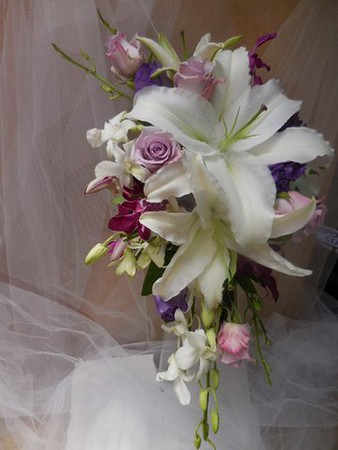 Cascade bouquet- roses, orchids white stargazer, lavender rose- $135