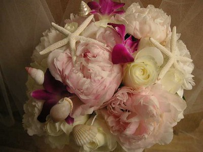 Pink peonies, roses  orchids and starfish/ shells $145