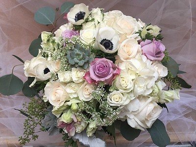 Ivory and white spray roses, queen anne's lace lavender roses, succulents, black eyed anemone, eucalyotu$135-$145