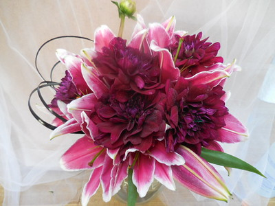 Burgundy dahlias, stargazers, black grass   $130
