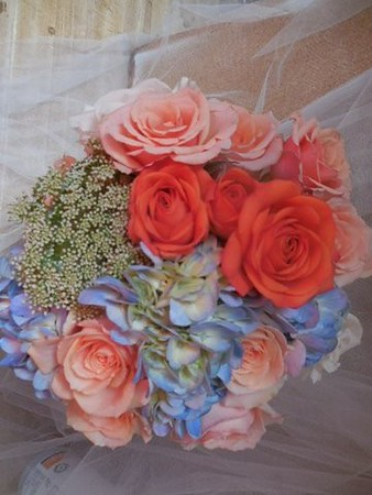 Blue hydrangea, peach and orange roses, queen anne's lace  $120