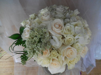 White hydrangea, queen anne's lace, roses, spray roses, snapdragons  $115