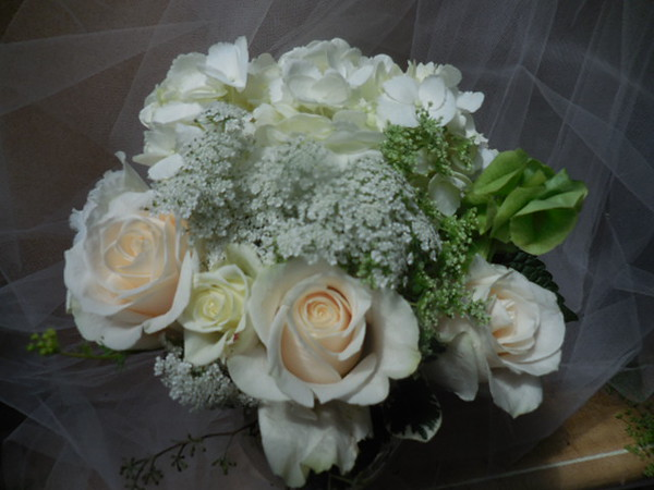 White roses, white hydrangea, queen anne's lace bell of Ireland- $55