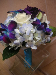 Blue hydrangea , blue orchids, roses $50