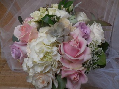 Mix  of whites blush lavender roses and hydrangea, succulent  $140