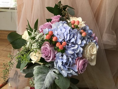 mix of blue hydrangea, peach beans, queen anne's lace lay roses $130