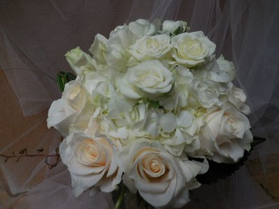 White roses, snapdragons, orchids $135