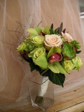 Green orchids green roses, curly willow branches $155