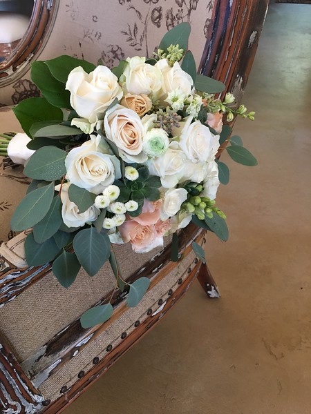 ivory roses, coffee colored roses, eucalyptus  $135