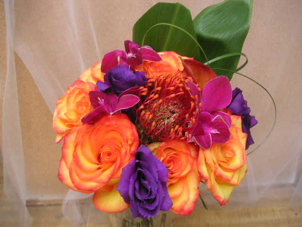 Circus roses, orchids, lisianthus pincushion $110