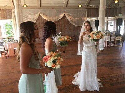 Peach roses, ivory roses  Bride- $135  bridesmaids $55