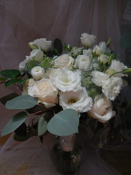 White lisianthus, ranunculus,  queen anne's rose eucalyptus  $125