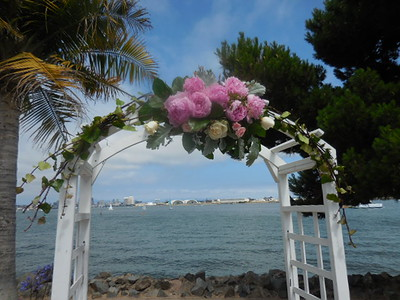 Bali Hai small arch centerpiece  with peonies $195