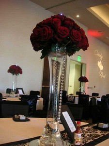 4 dozen roses  on pedestal $200