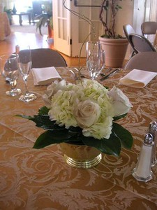 Gold cup of roses, hydrangeas, greens ,  branches $60