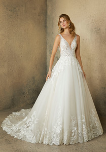 2089 Robin Wedding Dress Frosted, Embroidered Lace Appliqués on a Tulle Ball Gown with Crystal Beaded Neckline Trim and Wide, Scalloped Hemline with Extra Long, Sheer Train.