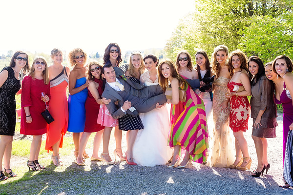 Bride and girlfriends hold up groom | Rayan Anastor Photography | Bowers Harbor Vineyard Wedding Photographer